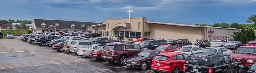 The Bridge church building and parking lot